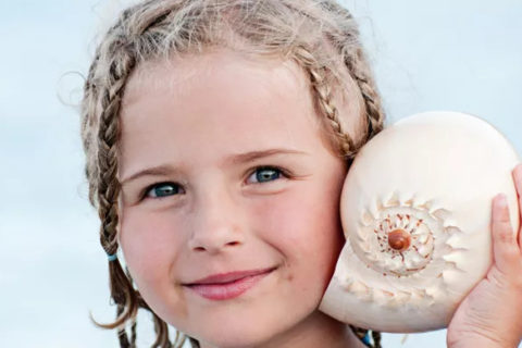 girl with shell on ear